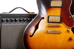 Electric guitar and amplifier on white background Stock Photos