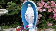 Madonna statue flower garden Stock Footage
