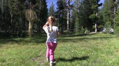 Butterfly hunter, alpine meadow Stock Footage