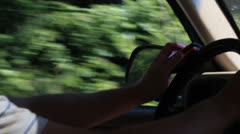 Texting and driving 101 on cellphone - stock footage