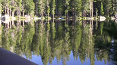 Scenic lake canoe beached Stock Footage