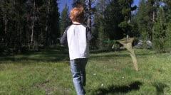 Redheaded boy stocks butterflies Stock Footage