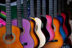 Row of multi-colored mexican guitars Stock Photos