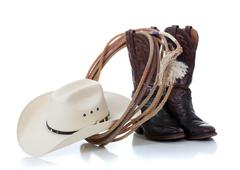 Cowboy hat, boots and lariat on white Stock Photos
