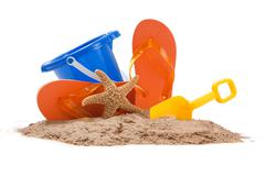 Beach scene with pail, flip-flops, starfish and shovel Stock Photos