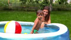 Kid in pool Stock Footage
