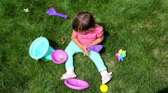 Girl with toys Stock Footage