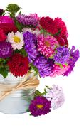 Bouquet of   aster flowers in metal pot Stock Photos