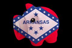 piggy rich bank in colors flag of american state of arkansas   for saving mon - stock photo