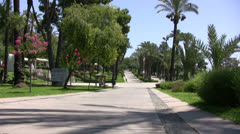 Public park in Antalya with cyclist Stock Footage