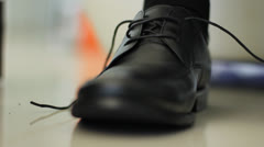 Man tying the shoelaces a pair of leather shoes Stock Footage