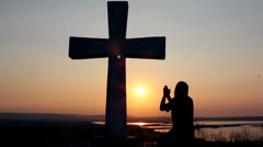 Man praying under the cross Stock Footage