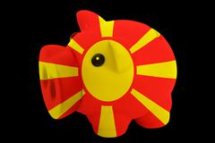 Piggy rich bank in colors national flag of macedonia   for saving money Stock Photos