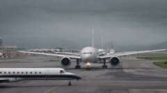 190 waiting for takeoff permission aircrafts on runway Stock Footage