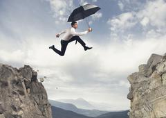Stock Illustration of businessman jumping over the mountains