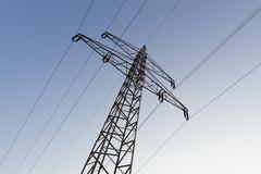 Electrical tower with power supply line against blue evening sky Stock Photos