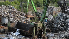 Processing scrap metal in baling machine united kingdom Stock Footage