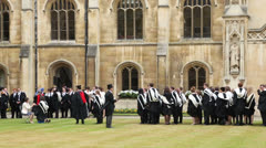 Cambridge university students in their gowns on graduation day Stock Footage