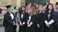 Cambridge university graduates wait to enter senate house to receive degree Stock Footage