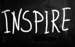 """inspire"" handwritten with white chalk on a blackboard Stock Illustration"
