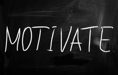 """motivate"" handwritten with white chalk on a blackboard - stock illustration"