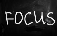 "The word ""focus"" handwritten with white chalk on a blackboard Stock Illustration"