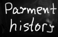 "Stock Illustration of ""payment history"" handwritten with white chalk on a blackboard"