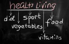 healthy living concepts on a blackboard - stock illustration