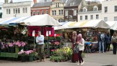 muslim and caucasian women, showing multicultural britain, cambridge market - stock footage