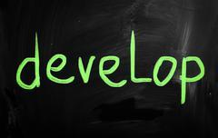 """develop"" handwritten with white chalk on a blackboard - stock illustration"