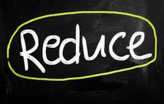 "Stock Illustration of ""reduce"" handwritten with white chalk on a blackboard"
