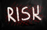 "Stock Illustration of ""risk"" handwritten with white chalk on a blackboard"