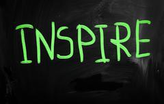 """inspire"" handwritten with white chalk on a blackboard - stock illustration"
