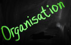 """organisation"" handwritten with white chalk on a blackboard Stock Illustration"