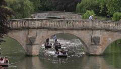 people punting on river cam, clare bridge, cambridge, england - stock footage