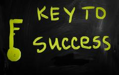 """key to success"" handwritten with white chalk on a blackboard - stock illustration"