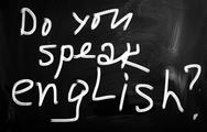 "Stock Illustration of ""do you speak english"" handwritten with white chalk on a blackboard"
