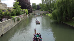 people punting on river cam, cambridge, england - stock footage