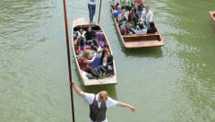 people punting on river cam cambridge, england - stock footage