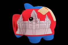 Bankrupt piggy rich bank in colors of national flag of cambodia    closed wit Stock Photos