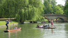 People punting on river cam, cambridge, england Stock Footage