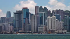 199 Skyscapers at Victoria's harbor and floating ship, Hong Kong Stock Footage