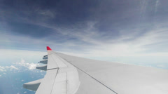 Wing of passenger airplane - view through the window Stock Footage
