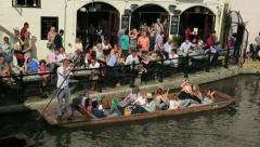 people punting on river cam at the anchor inn, cambridge, england - stock footage
