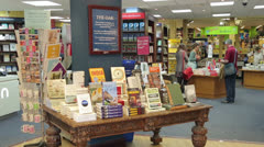 pan of inside of bookshop, cambridge, england - stock footage