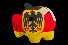 Bankrupt piggy rich bank in colors of national flag of germany    closed with Stock Photos