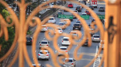 Sao Paulo car traffic seen through a guard rail - stock footage