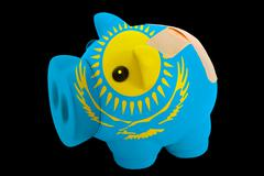 bankrupt piggy rich bank in colors of national flag of kazakhstan    closed w - stock photo