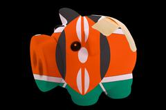 Bankrupt piggy rich bank in colors of national flag of kenya    closed with b Stock Photos