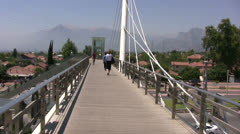 Modern footbridge over a main road in Antalya Stock Footage